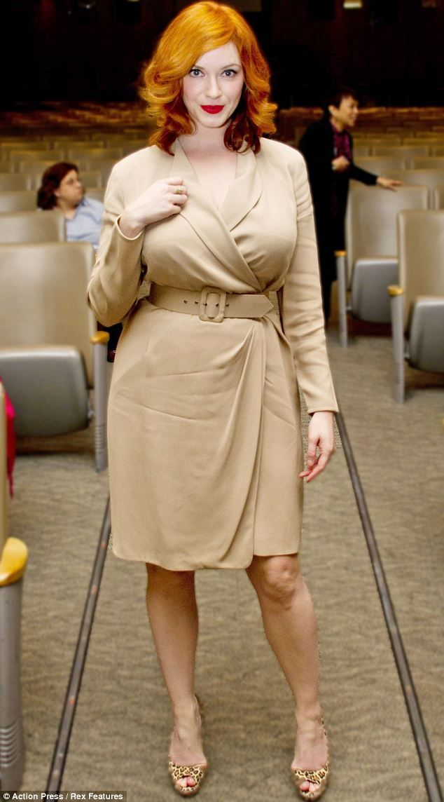 Stunning: Christina Hendricks wowed in nude dress coat at a Mad Men press  conference on Monday