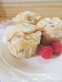 Raspberry Key Lime Cream Cheese Muffins- Sweet raspberries & tart key lime come together in this cream cheese swirled muffin, recipe on thefrugalfoodiemama.com