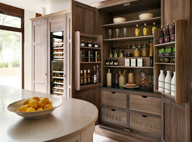 Larder cupboard with steb shelving with quick access, and packet racks inside the doors