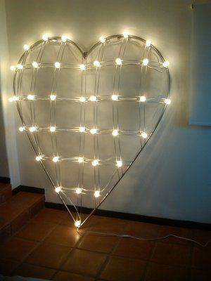6 foot stainless steel heart sculpture with lights