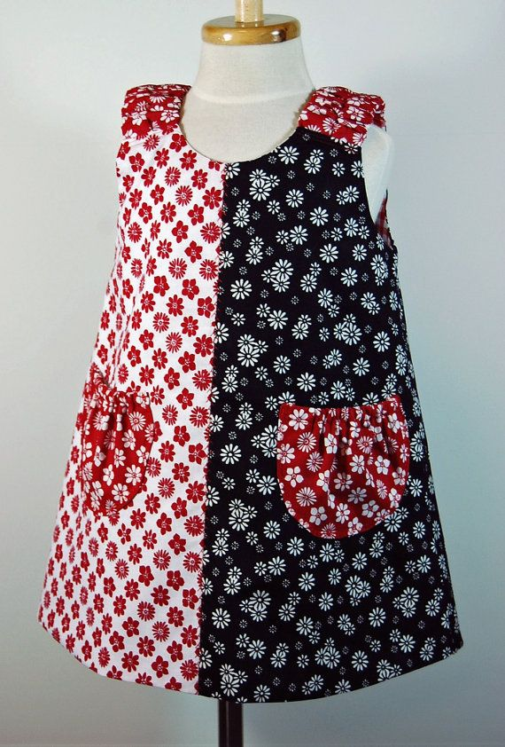 For kids, but just SO derned cute! Olivia the Pig Jumper in Red Black and White by pinkmouse, $34.00