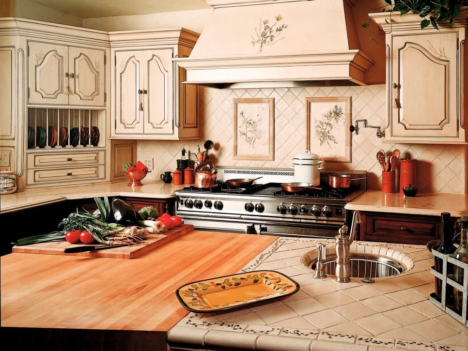 With a wide range of colors and textures available, tile countertops can be customized to fit the style of any kitchen. Tiles can crack and require grouting, so they are a little more high maintenance than other countertop surfaces. Design by Didier Michot