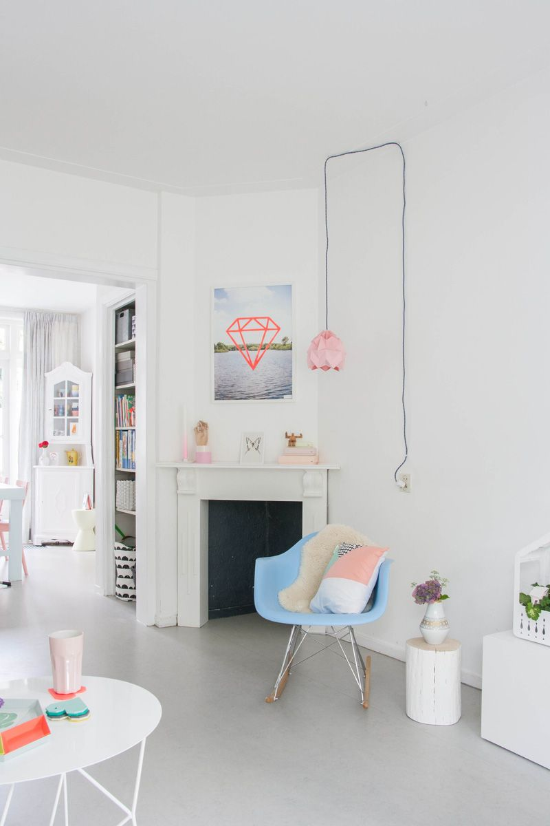 Home tour bright cheerful dutch row house eames chairs pillows