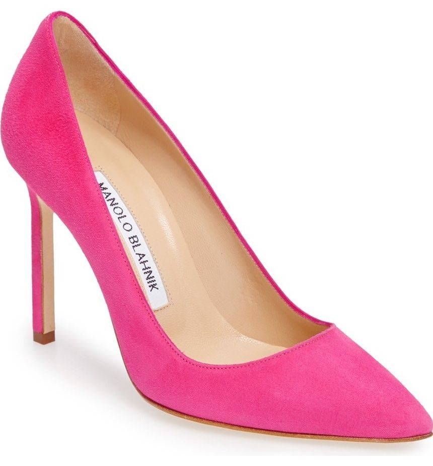 Swooning over this classic pointy-toe pump that dazzles in a pop of pink.