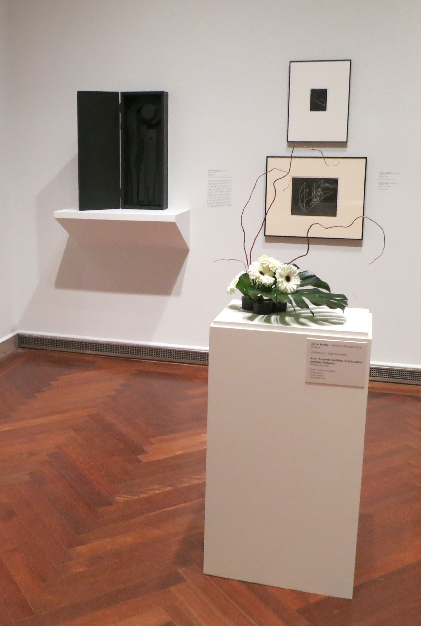 Gallery view: floral designer: Joyce Bakshi, Andover Garden Club | art: Louise Nevelson, Untitled | plant material: Cone Flower, Curley Willow, Monstera Leaf