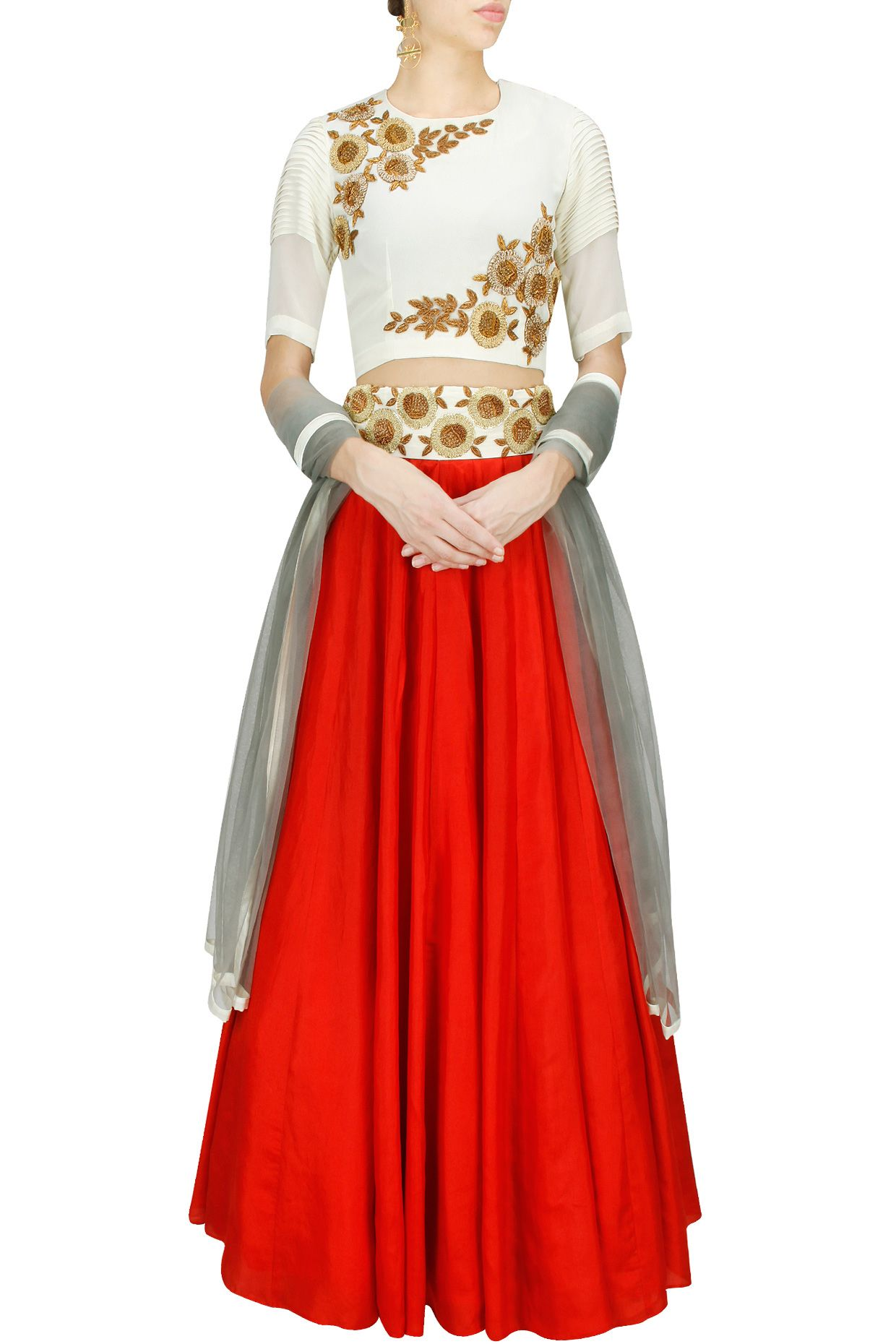 Red and off white embroidered lehenga set BY BHUMIKA SHARMA.