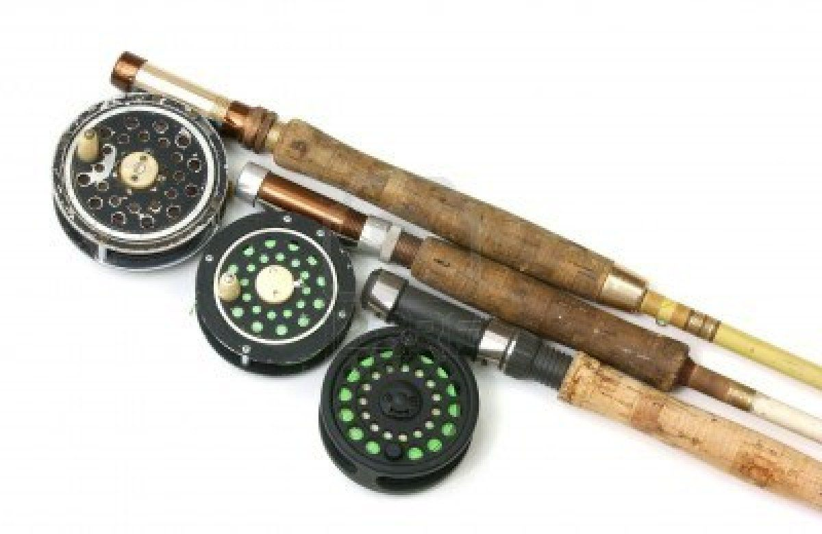 Three old fly fishing rods and reels stock photo for Old fishing poles
