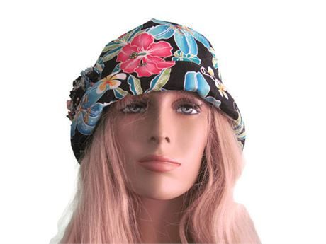 ee03bd1a410 Black tropical flower print bucket cloche hat. Hat is 100% cotton. Brim can