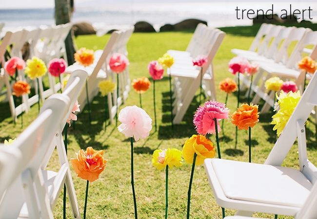 15 chic ways to use paper flowers at your wedding paper flowers 10 cool ways to rock paper flowers at your wedding theknot mightylinksfo Gallery