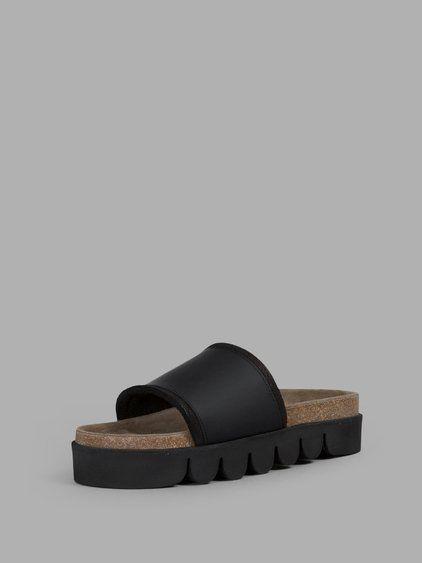 f83ce75a5813 HENDER SCHEME HENDER SCHEME MEN S BLACK CATERPILLAR SLIPPER.  henderscheme   shoes  sandals
