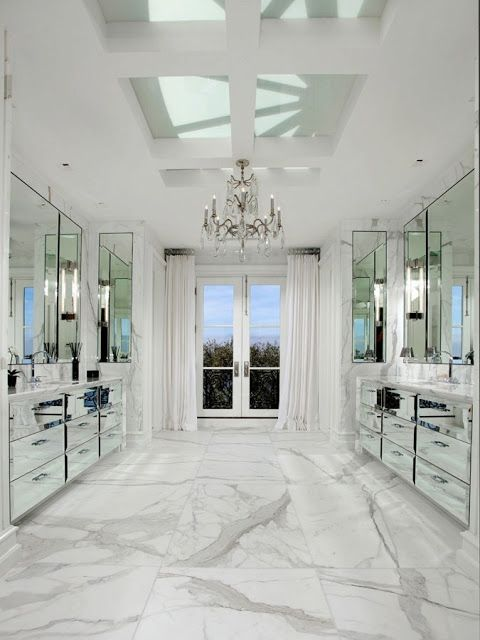 Mirrored Vanity Cabinets White Carrara Marble Floors And A Chandelier All Add To The Sparkle In The Master Luxury Decor Beautiful Bathrooms White Marble Floor
