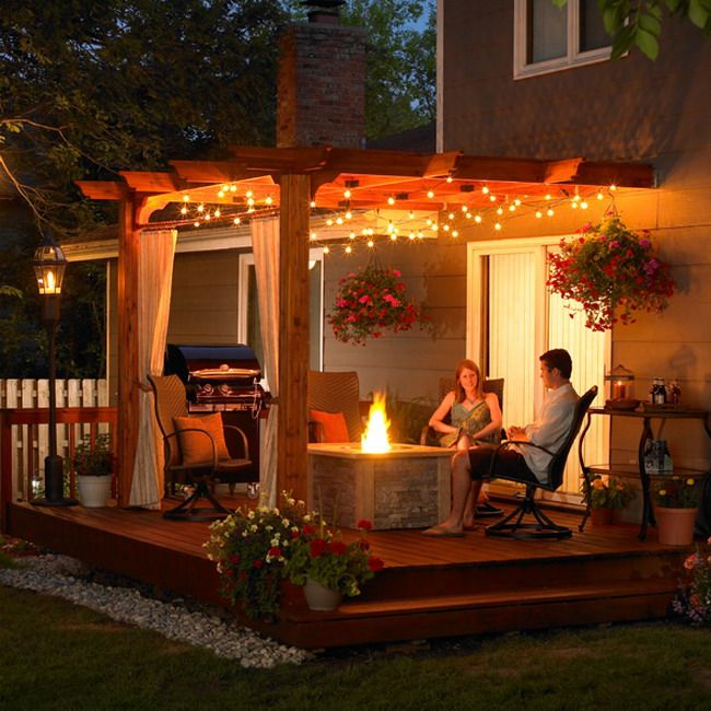 Outdoor patio ideas with wooden cover and modern lighting for Pinterest small patio ideas