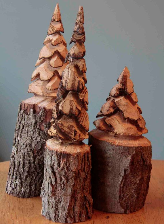 Set of chainsaw carved pine trees make by