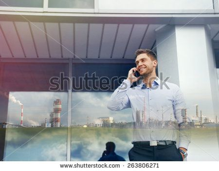 double exposure of businessman with phone device and industrial enterprise on urban building background