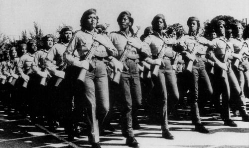 A brigade of Cuba's Territorial Troops Militia (MTT),  in a 1990 photo. The MTT is a volunteer military force which continues the fighting tradition of those who fought at Playa Giron and against banditry, the latest incarnation of the citizens' active participation in the defence of the nation. In the MTT, as in all of Cuba's armed forces, women play an important role.