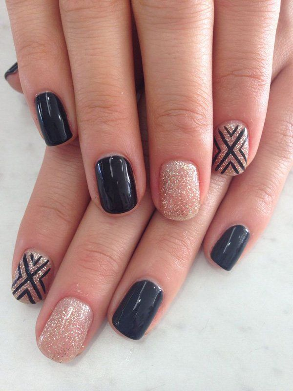 Pretty looking nail art in black matte, silver dust with criss-cross details in black polish.