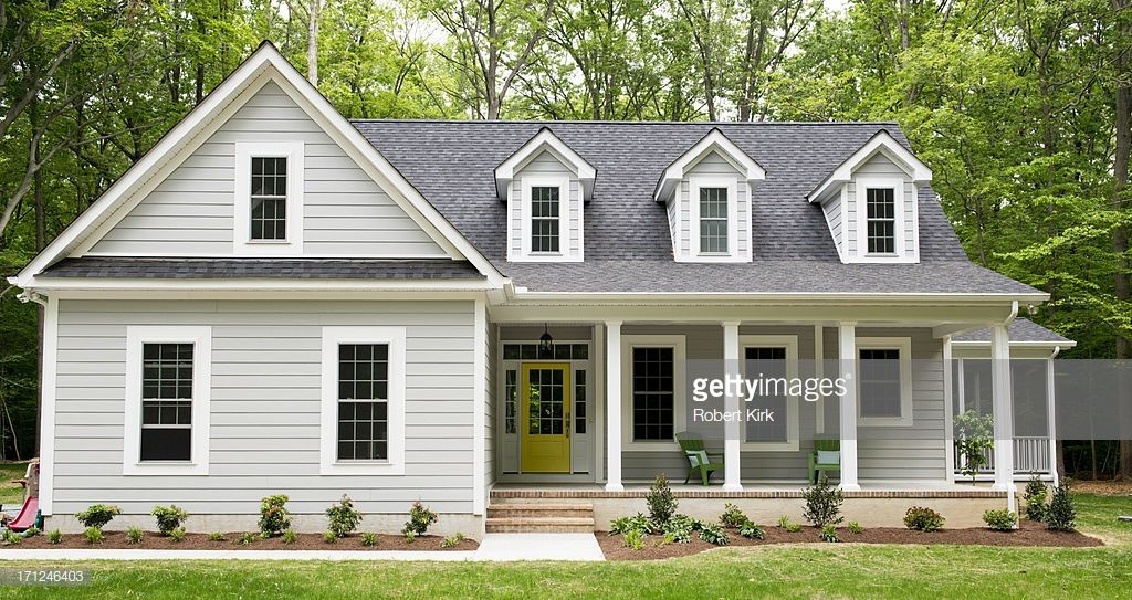 Exterior Of A New Cape Cod Styled Suburban House With Recently Cape Cod House Exterior House Exterior Exterior Siding Options
