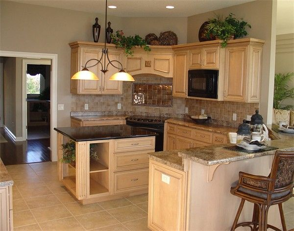 simple greenery above cabinets   Kitchen cabinets decor ...