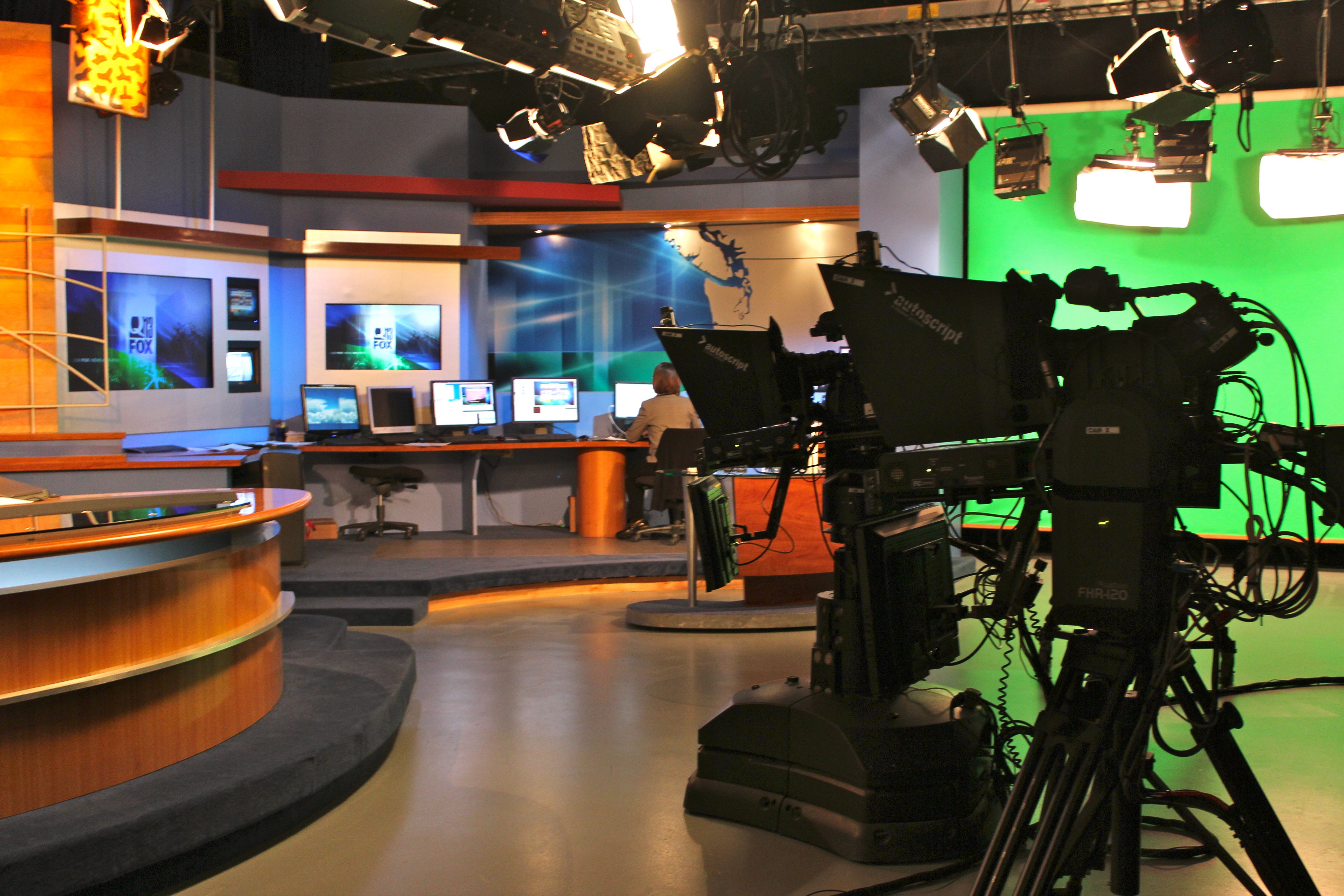 Behind the scenes in the newsroom-- M J  working away at the weather