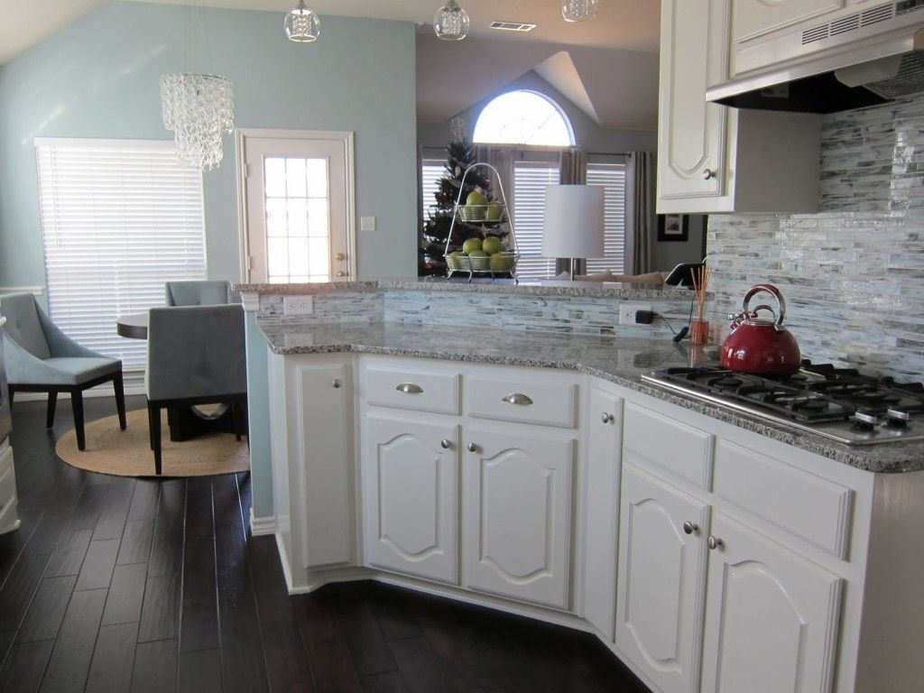 White Cabinets Gray Counter Cherry Wood Floor Red Cookware Kitchen Remodel Cost Kitchen Remodel Design Kitchen Remodel Small