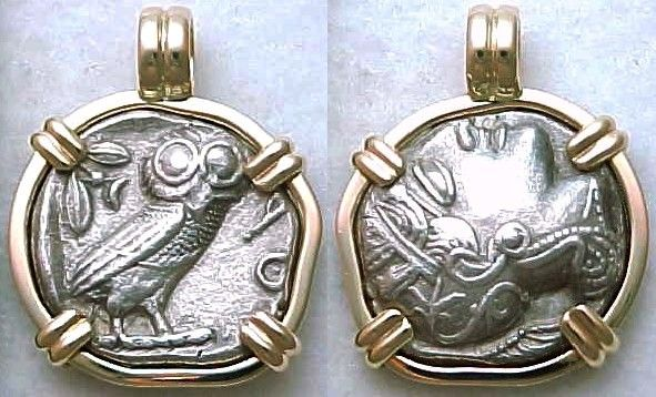 Coin - tetradrachm from ancient Athens Greece. Early style Athenian owl (449-413 BC). Reverse: Owl standing right, olive spray and crescent behind, AOE signifying Athens in front. Obverse: Early archaic style head of Athena. Coin is mounted in a heavy 14k gold bezel with fixed bale, and with bezel, is about the size of a quarter.
