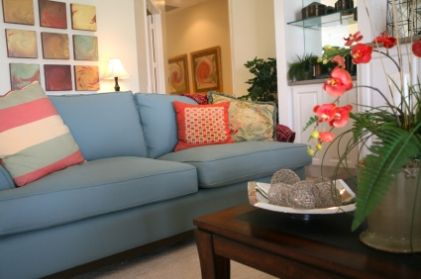 Living Room Decorating Blue Sofa With Samen Red Pillowsalso Could Have Yellow White Throw Pillows