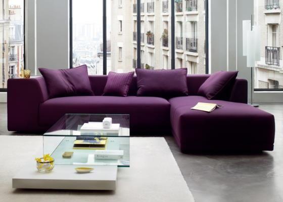 Wonderful Livingrrom Design Idea With Huge Size Glass Windows And Square  Shaped White Carpet Floor And L Shaped Purple Sofa Set Feat Small Purple  Cushions ...
