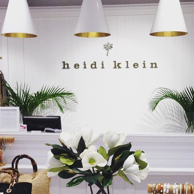 I was in the gorgeous white Heidi Klein boutique in London recently and it struck me how you could borrow ideas for a glamorous white home from the white and brass pendants to the white beadboard walls and pale white-washed wooden floor...