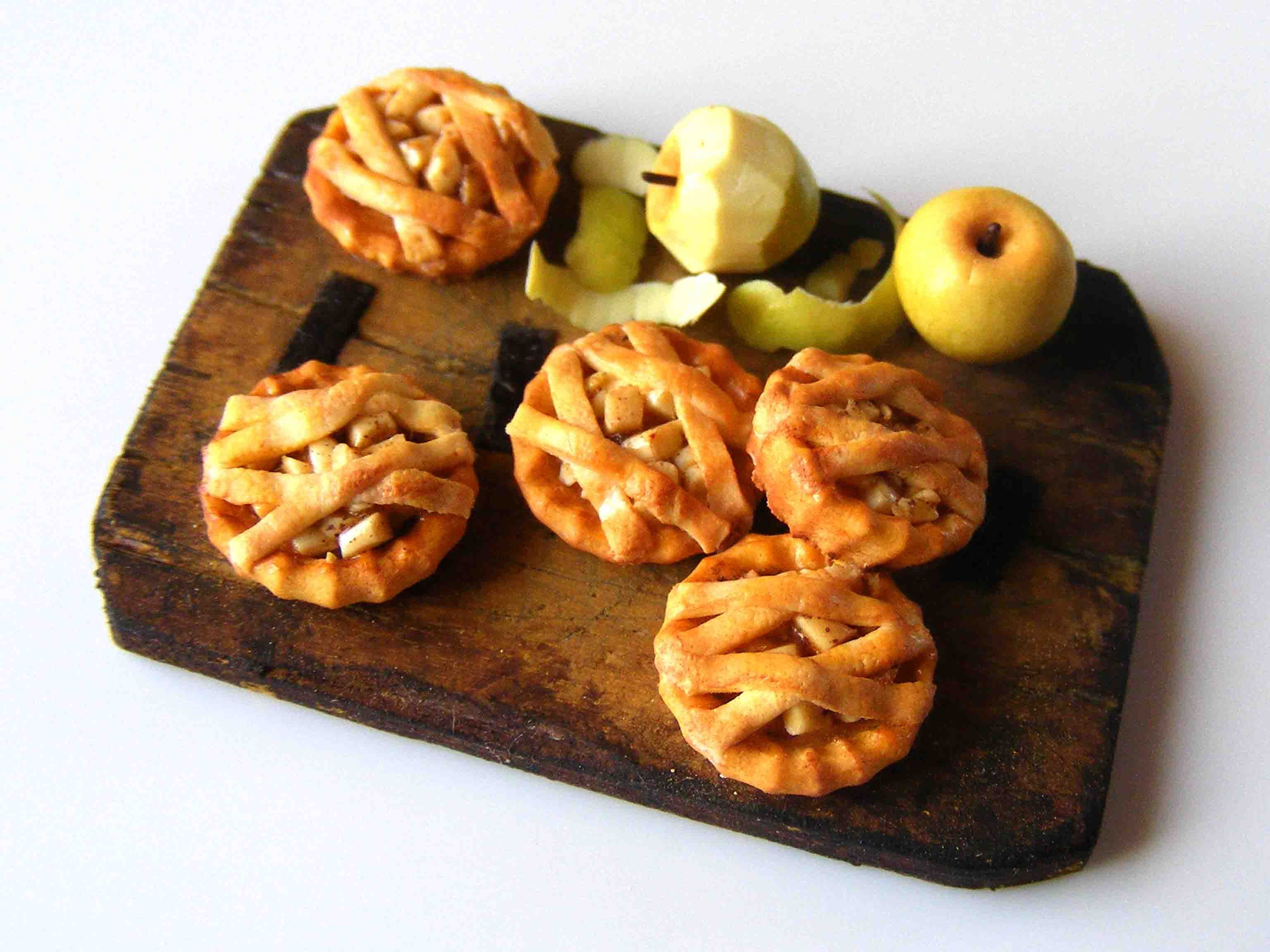 Miniature Apple Tartlets With Pealed And Whole Apple