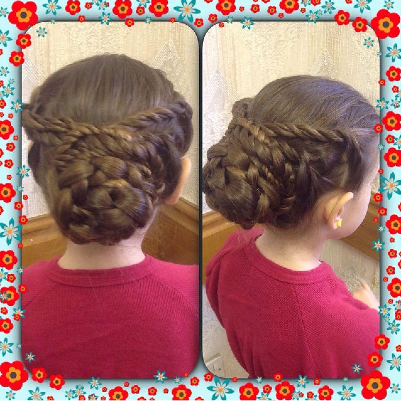 Liquorice braids wrapped around d round braided bun  Punzels Hair