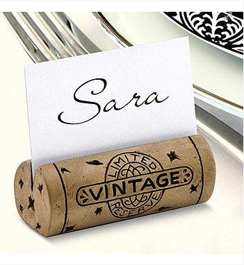 Easy dinner party idea: Slit the top of a wine cork and insert a name tag for a cute and unique place holder