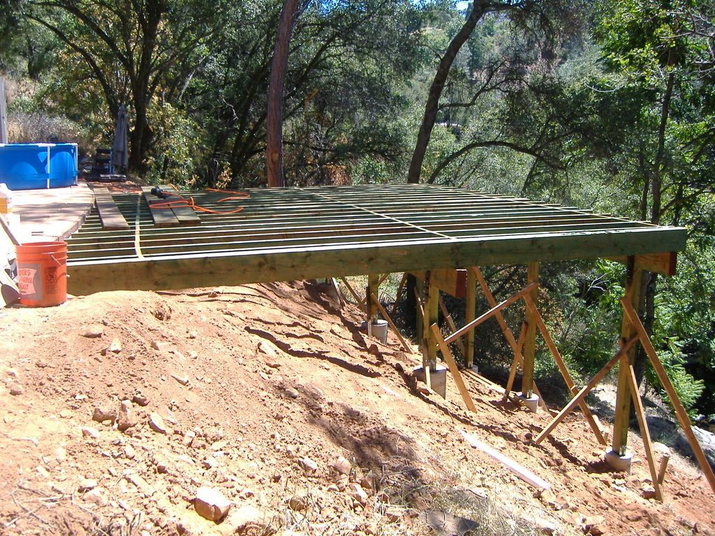 Building a 24 39 x 20 39 deck on steep slope side of the for Decking at end of garden