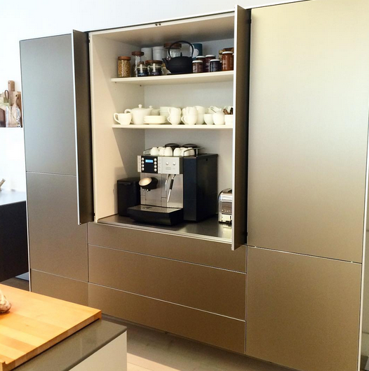 This #champagne finish at #Balthaup #cabinetry showroom is great! We also love the hidden coffee center behind doors.