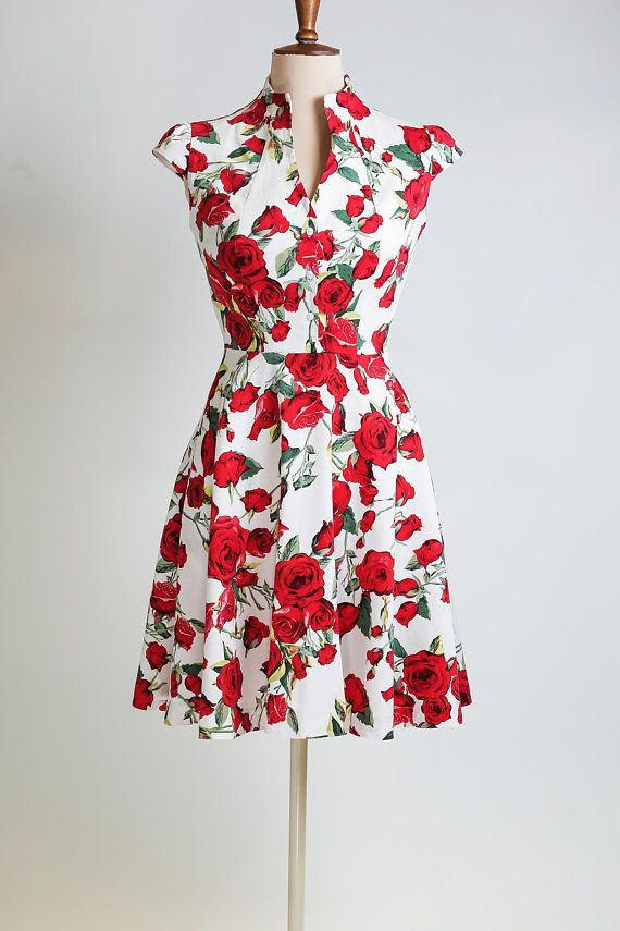 6d998264ca88 Beautiful floral summer dress with red roses in a white background. This  dress is very elegant with a vintage look, and it is ideal for countless  occasions, ...