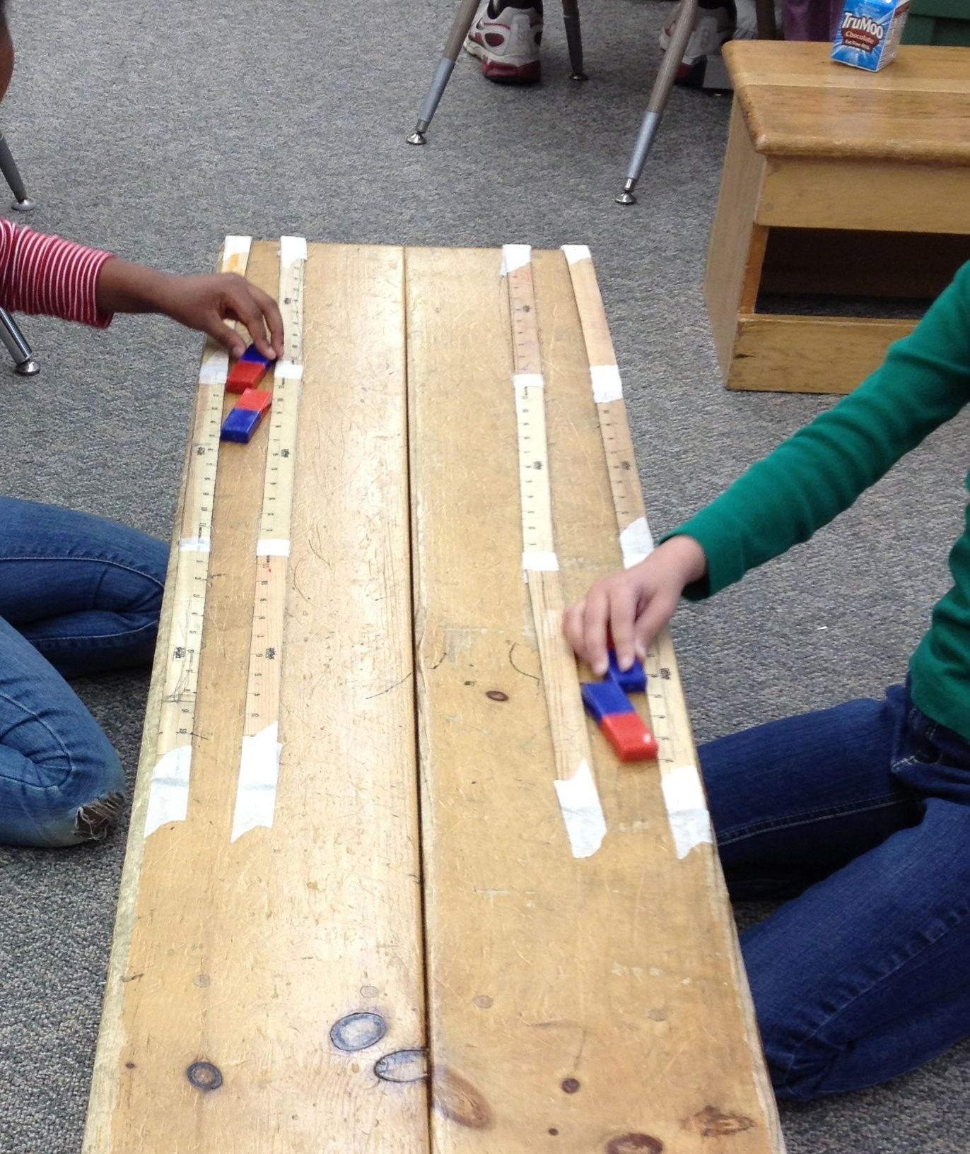 Magnet Repel Racing With Rulers Along A Bench