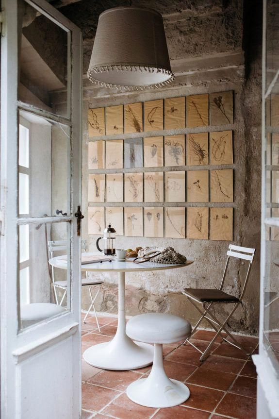 beautiful dining room designed by prop stylist heather bullard. #heatherbullard #propstylist #styling #diningroom #diningspace #artgallerywall #artcollection #art #artwall #lighting #diningnook #elledecor