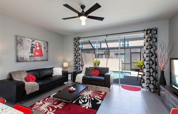 Idee De Deco Salon En Cuir Realiste Canape Noir Murs Gris Rouge Passion Sol  Carrele Rideaux