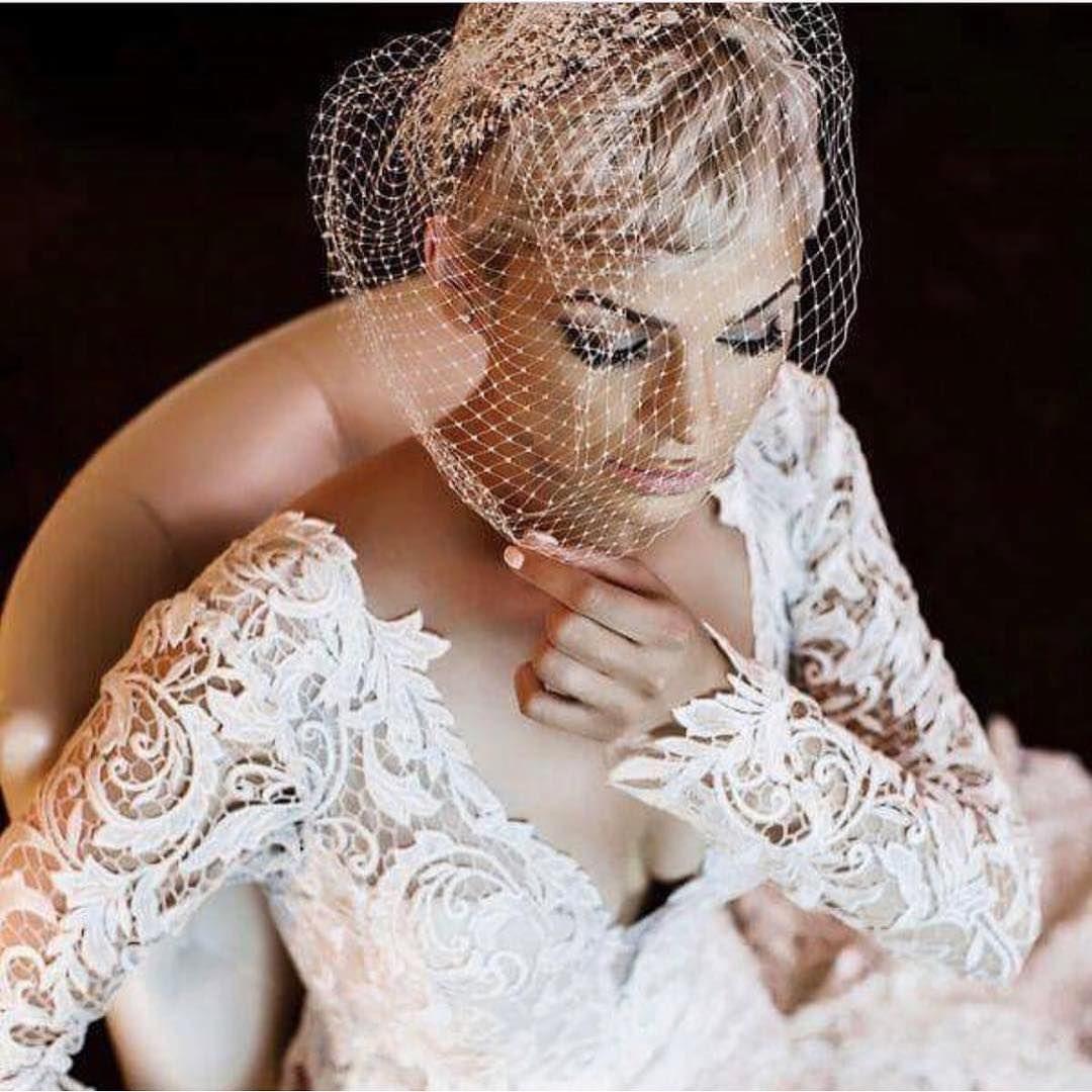 A kleinfeldbride paired a lace vneck long sleeve wedding dress