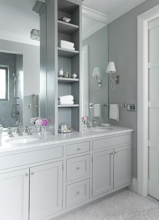 lovely Grey Master Bathroom Part - 9: Grey master bathroom features gray shaker washstands topped with white  marble fitted with his and her sinks under full height frameless mirrors  flanking a ...