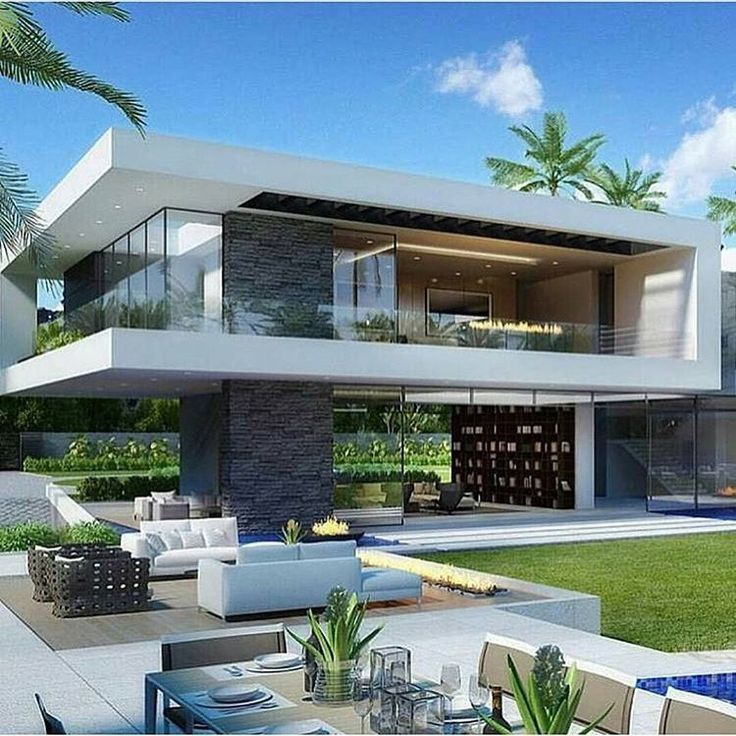 Modern Architecture Home With An Open Living Room To The Garden .