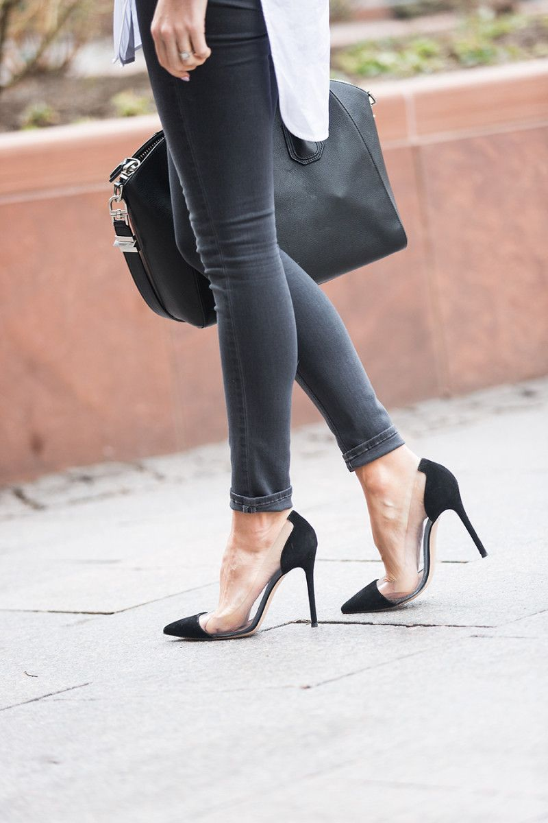 167d1c453c20 Wondering which shoes to wear with black skinny jeans? Look no further than  Emily Jackson's stylish combination of sleek black translucent heels and a  pair ...