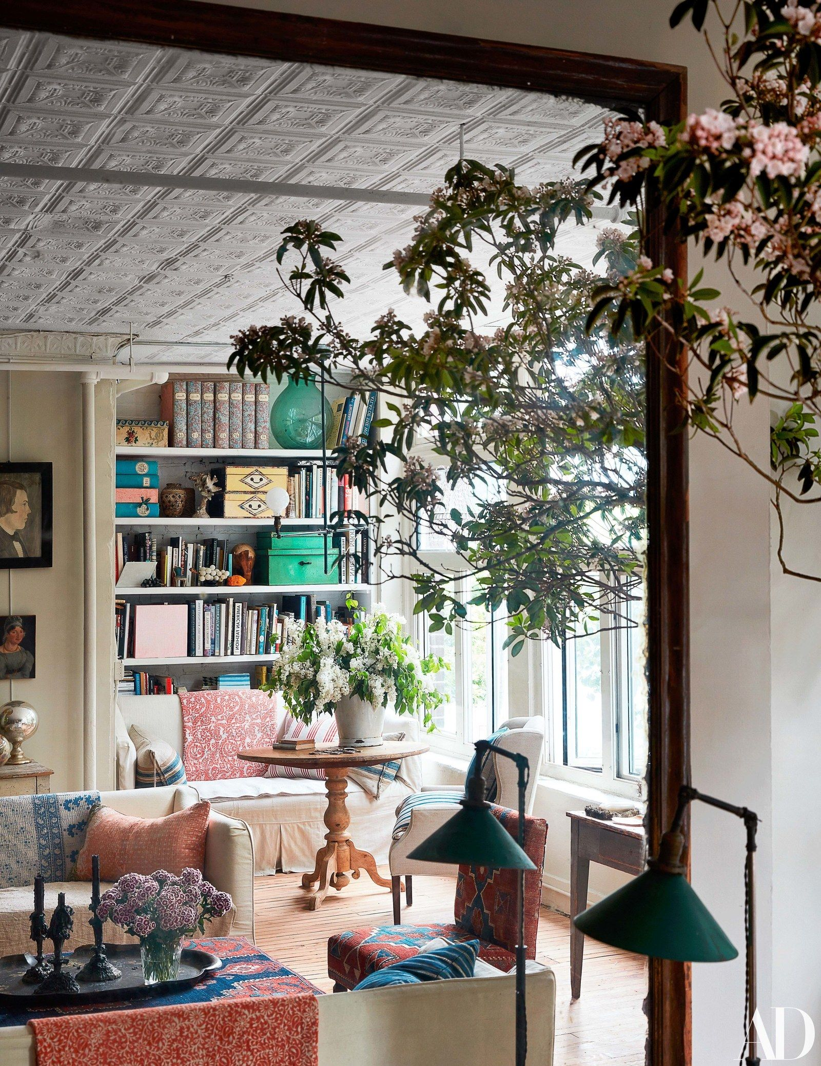 corner of the living room as seen in reflection an antique mirror is also john derian   new york city abode charming and eclectic his rh pinterest