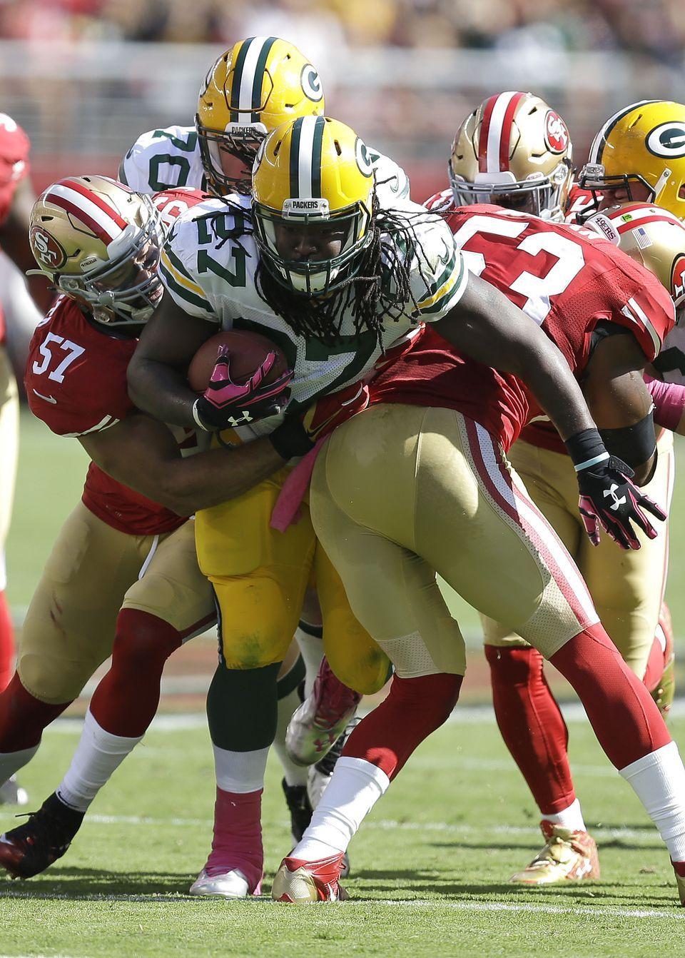 Green Bay Packers Running Back Eddie Lacy 27 Runs Between San Francisco 49ers Linebacker Michael Wilhoite 57 Nfl Football Games Navorro Bowman Nfl Football