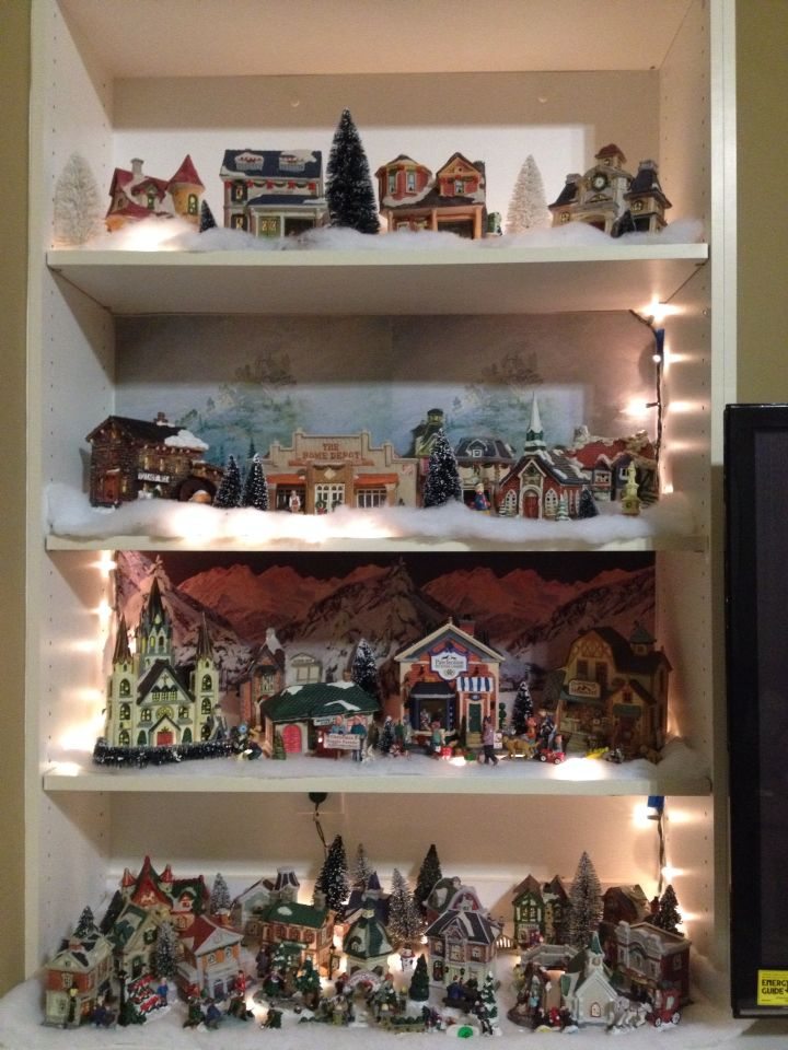 Christmas village on entertainment stand shelf. Love the new Home ...