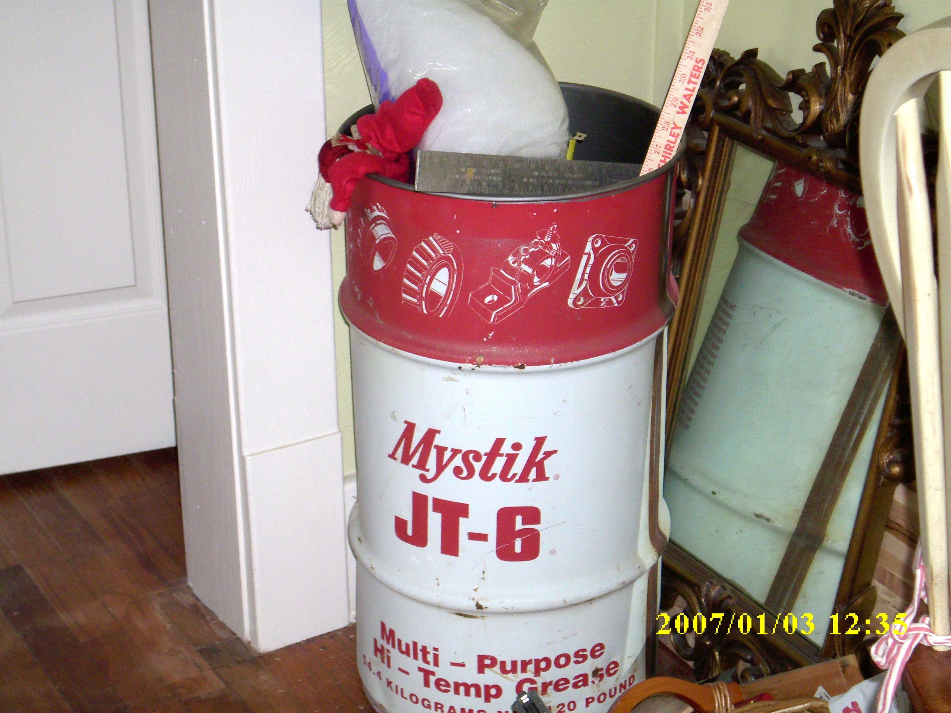 found this on side of road and put dirt in it to clean out grease and washed with soapy water and dried good and painted inside with slate gray color.  Love it and good for lots of storage, ie wall or wrapping paper, yard sticks, curtain rods, etc.  Love this can!