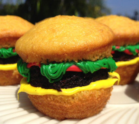 """It may look like a savy treat, but don't be fooled, this cheeseburger themed cupcake is as sweet and tasty as it gets. Made from a split in half cupcake, homemade icing, and fresh brownies as the """"meat,"""" there will be no disappointment at your next BBQ. Each quantity includes a dozen 'burgers', professionally boxed, and freshly made when you order."""