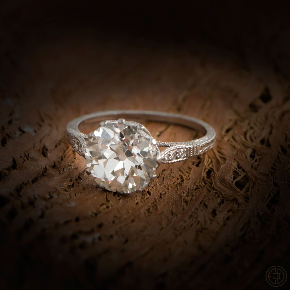a stunning solitaire platinum engagement rings with two small