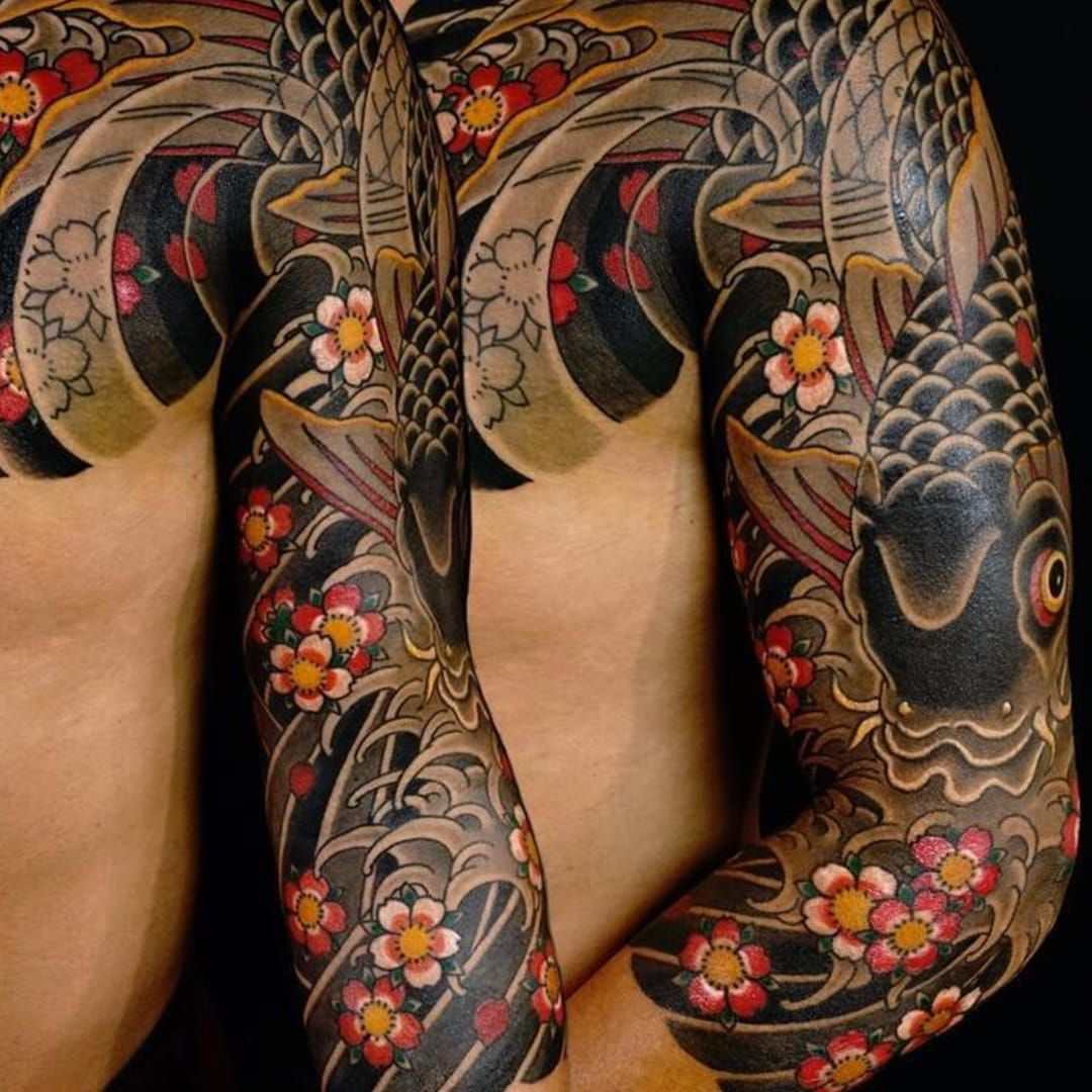 Traditional japanese tattoos swirling with cherry blossoms for Japanese tattoo