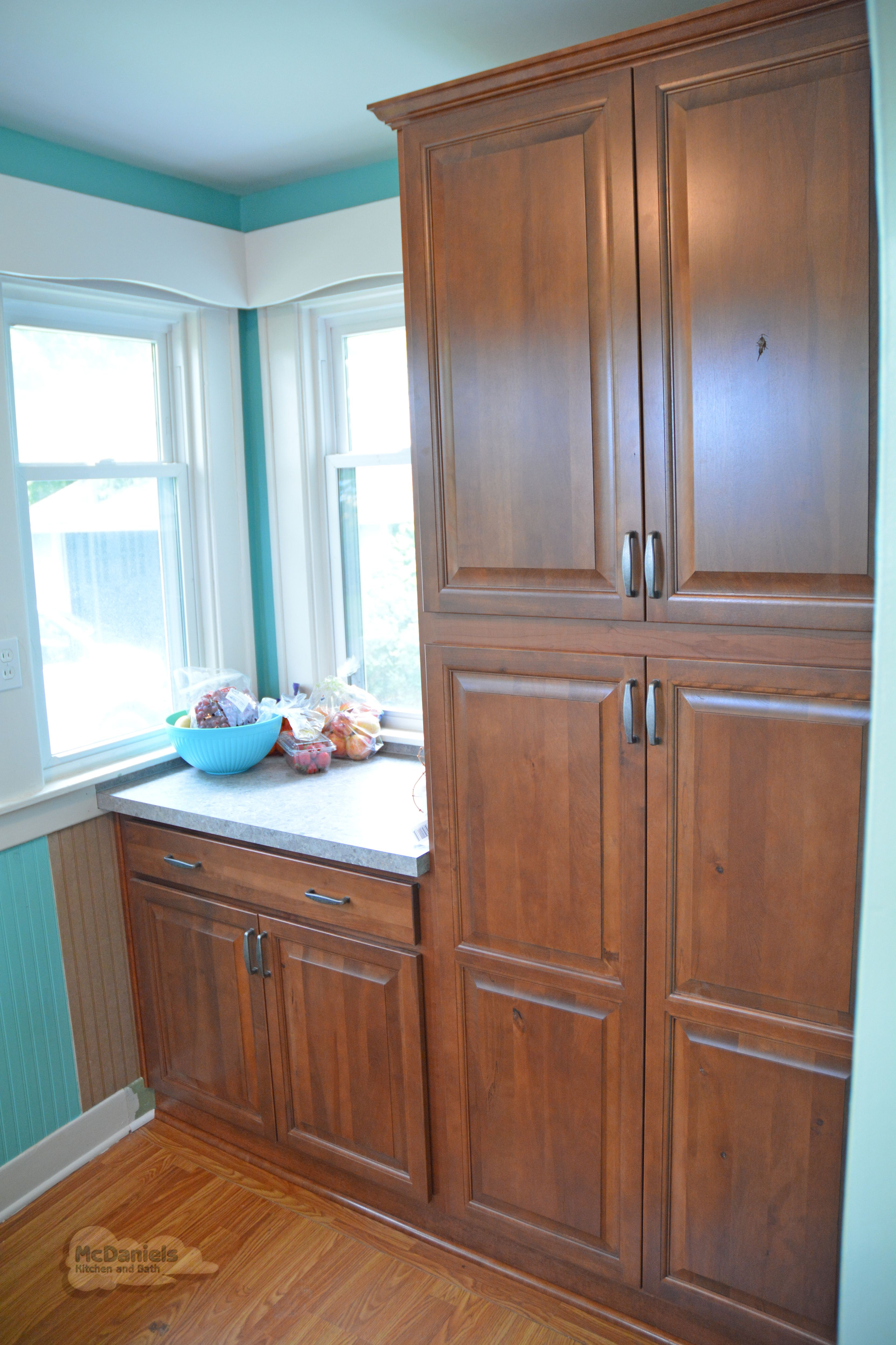 Cabinet Hardware Accents The Style And Finish Of Your Kitchencabinets In This Lansingmi Kitchendesign Richelieuhard In 2020 Design Tall Cabinet Storage Warm Wood