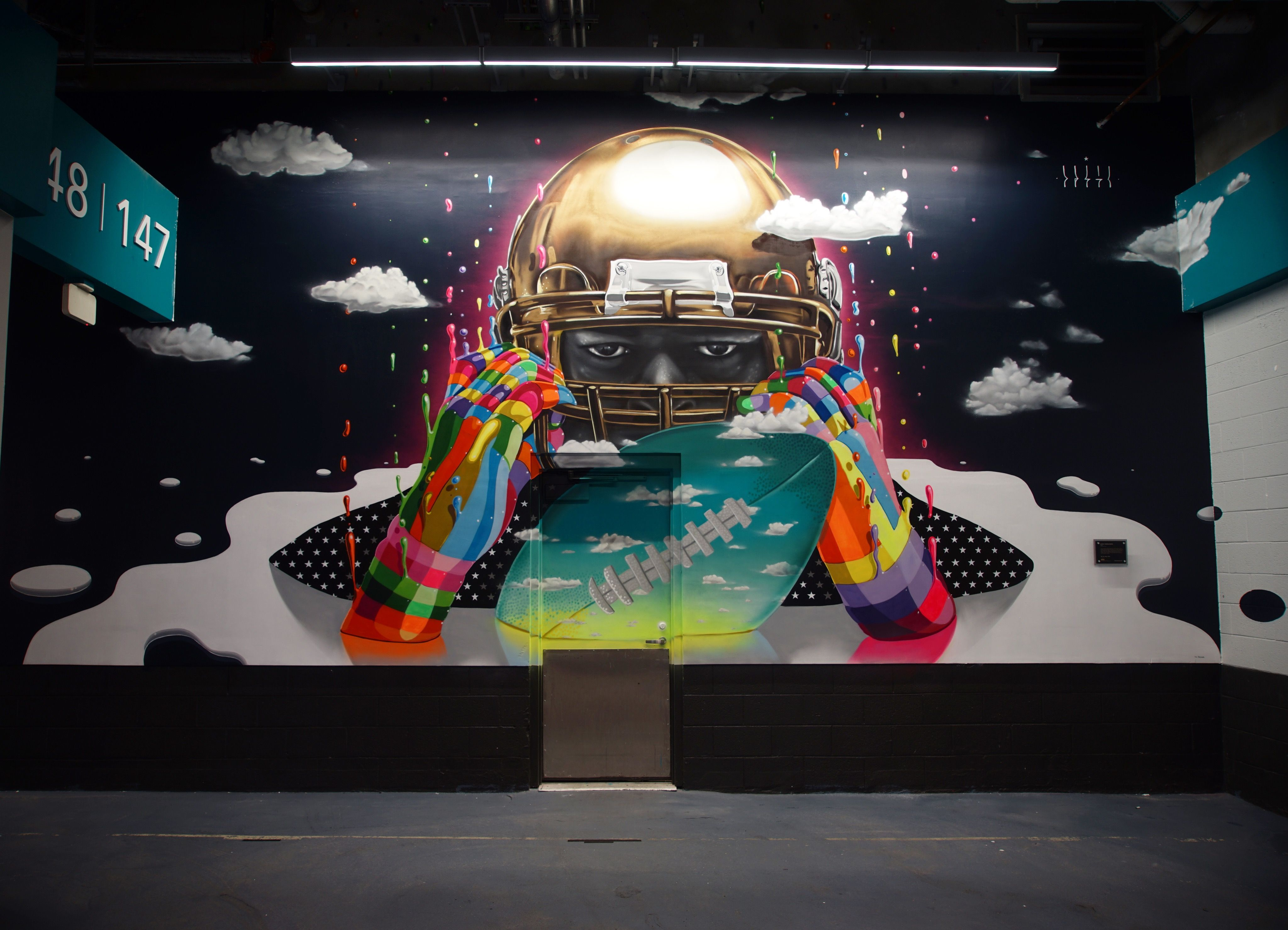 Street artists paint the walls of the new miami dolphins stadium mural for the miami dolphins stadium by dasic fernandez voltagebd Choice Image